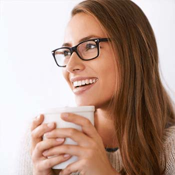 Woman smiling and holding a drink