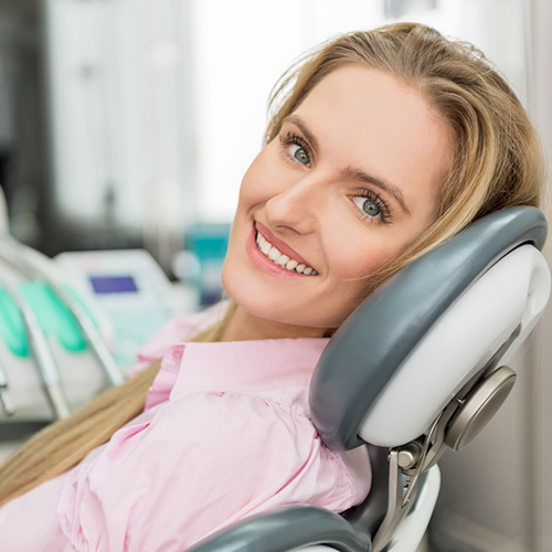 Female patient smiling in the dentist's chair
