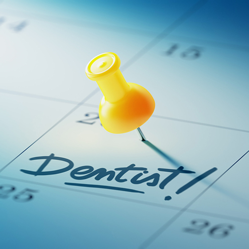 Dentist appointment marked on a calendar with a pin